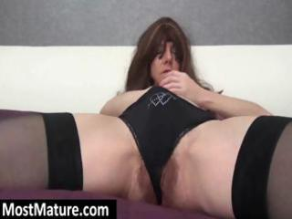 wearing some black stockings a sexy milf digs her