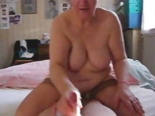 my aunt loves to jerk the cock. hidden cam