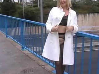wife in black tights hose flashing on a busy