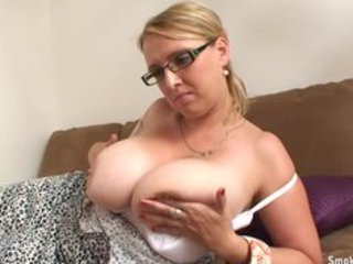 blonde milf with gigantic boobs smokes