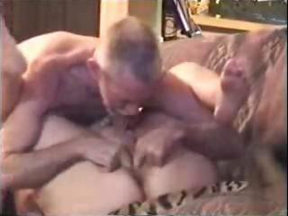 old mature golden-haired is getting licked and