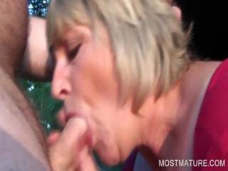 outdoor blowjob with golden-haired mature
