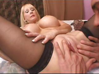 golden-haired granny with large fake breasts