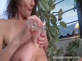 lascivious aged engulfing and fucking dildo